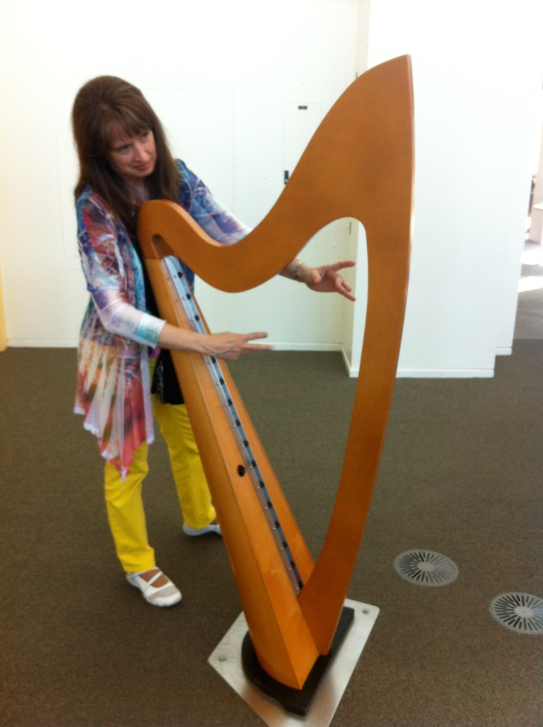 My mom playing the stringless harp.  Doesn't she look like a natural? So graceful!