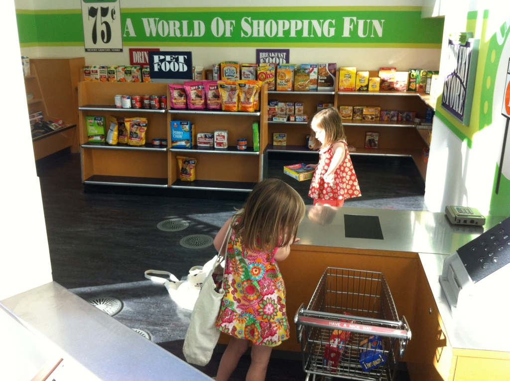 The girls did an impressive job of honing their consumer skills at the child-sized grocery store.
